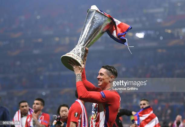 Fernando Torres of Atletico Madrid celebrates with the trophy after winning the UEFA Europa League Final between Olympique de Marseille and Club...
