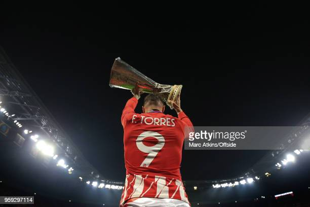 Fernando Torres of Atletico Madrid celebrates with the trophy during the UEFA Europa League Final between Olympique de Marseille and Club Atletico de...