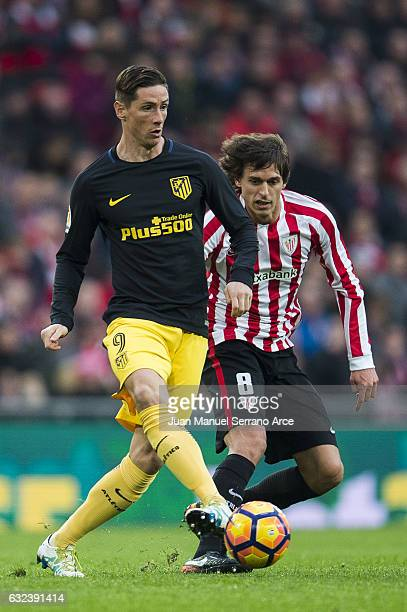 Fernando Torres of Atletico Madrid competes for the ball with Ander Iturraspe of Athletic Club during the La Liga match between Athletic Club Bilbao...