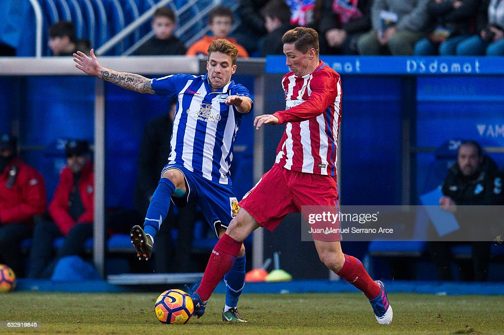 Fernando Torres of Atletico Madrid duels for the ball with Francisco Femenia of Deportivo Alaves during the La Liga match between Deportivo Alaves and Atletico Madrid at Mendizorroza stadium on January 28, 2017 in Vitoria-Gasteiz, Spain.