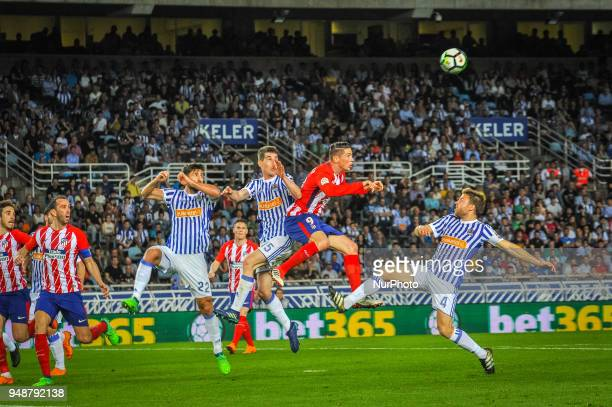 Fernando Torres of Atletico Madrid duels for the ball with Raul Navas Aritz Elustondo and Illarramendi of Real Sociedad during the Spanish league...
