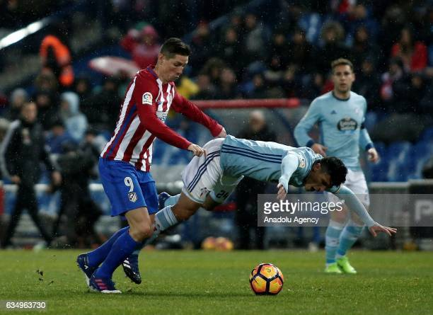 Fernando Torres of Atletico Madrid in action against Facundo Roncaglia of Celta Vigo during the La Liga football match between Atletico Madrid and...