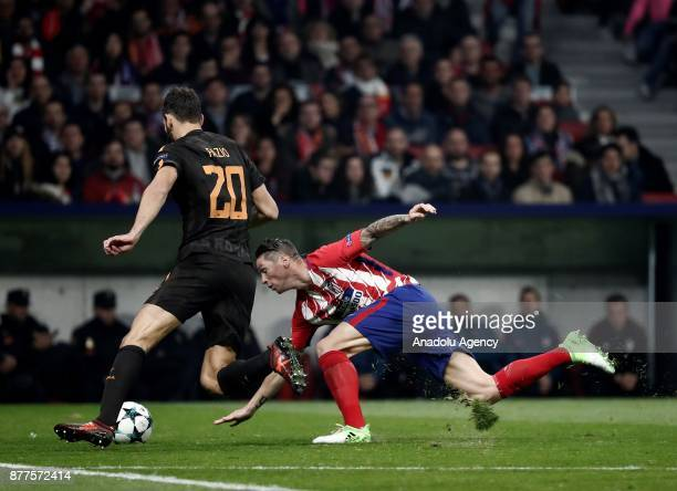 Fernando Torres of Atletico Madrid in action against Federico Fazio of AS Roma during the UEFA Champions League Group C match between Atletico Madrid...