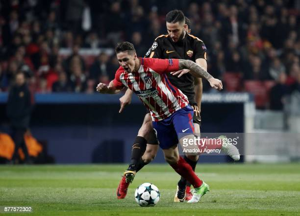Fernando Torres of Atletico Madrid in action against Kostas Manolas of AS Roma during the UEFA Champions League Group C match between Atletico Madrid...