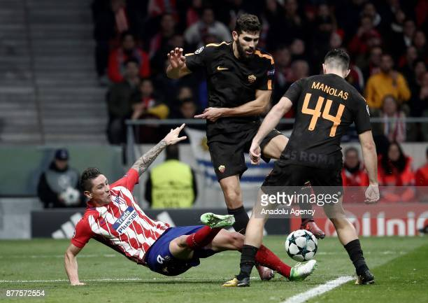 Fernando Torres of Atletico Madrid in action against Kostas Manolas and Federico Fazio of AS Roma during the UEFA Champions League Group C match...