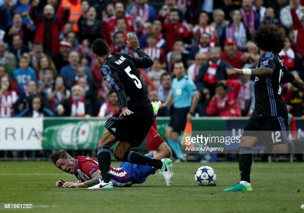 Fernando Torres of Atletico Madrid in action against Raphael Varane of Real Madrid during the UEFA Champions League semi final second leg match...
