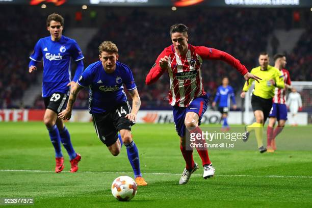 Fernando Torres of Atletico Madrid in action with Peter Ankersen of FC Copenhagen during UEFA Europa League Round of 32 match between Atletico Madrid...
