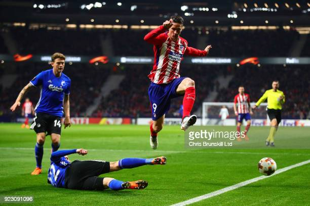 Fernando Torres of Atletico Madrid is challenged by Peter Ankersen of FC Copenhagen during UEFA Europa League Round of 32 match between Atletico...