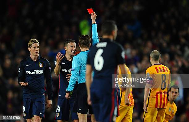 Fernando Torres of Atletico Madrid is shown a red card by referee Felix Brych and is sent off during the UEFA Champions League quarter final first...