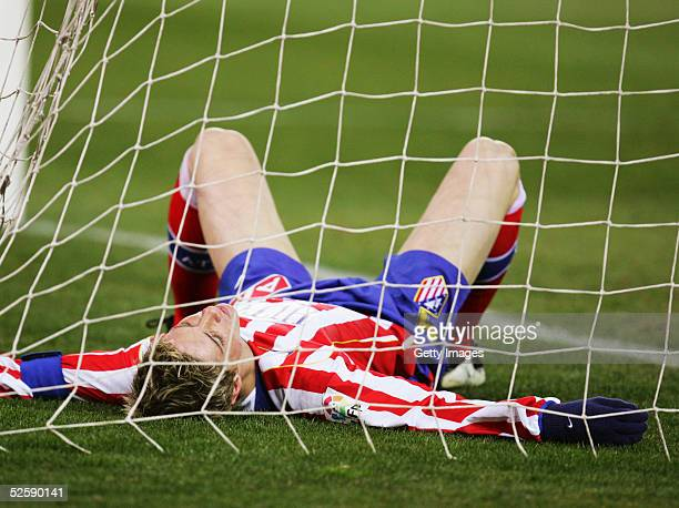 Fernando Torres of Atletico Madrid lays in the goal following a missed chance during a La Liga soccer match between Atletico Madrid and Real Sociedad...