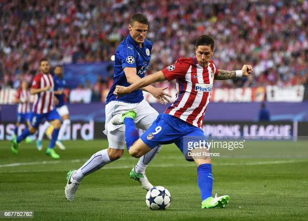Fernando Torres of Atletico Madrid shoots as he is closed down by Robert Huth of Leicester City during the UEFA Champions League Quarter Final first...