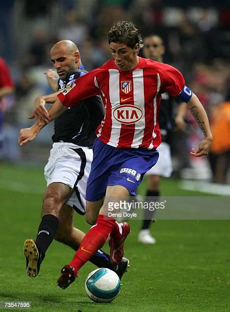 Fernando Torres of Atletico Madrid vies for the ball against Manuel Pablo of Deportivo La Coruna during the Primera Liga match between Atletico...