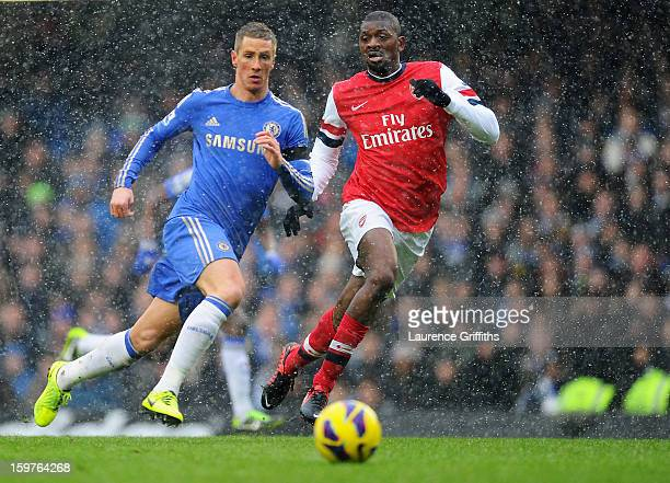 Fernando Torres of Chelsea and Abou Diaby of Arsenal watchd the ball during the Barclays Premier League match between Chelsea and Arsenal at Stamford...