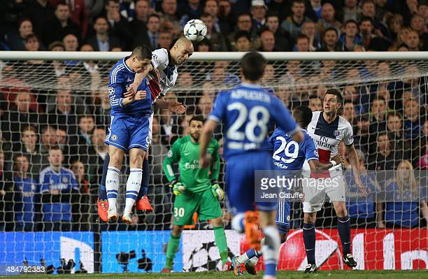 Fernando Torres of Chelsea and Alex Dias Da Costa of PSG in action while Thiago Motta of PSG looks on during the UEFA Champions League quarter final...