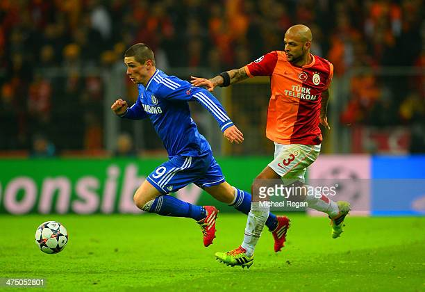 Fernando Torres of Chelsea and Felipe Melo of Galatasaray battle for the ball during the UEFA Champions League Round of 16 first leg match between...