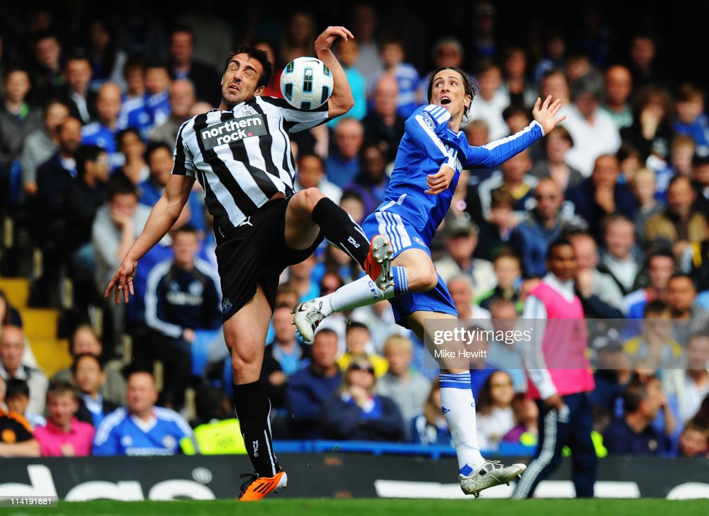 Fernando Torres of Chelsea (R) and Jose Enrique (L) of Newcastle United challenge for the ball during the Barclays Premier League match between Chelsea and Newcastle United at Stamford Bridge on May 15, 2011 in London, England.