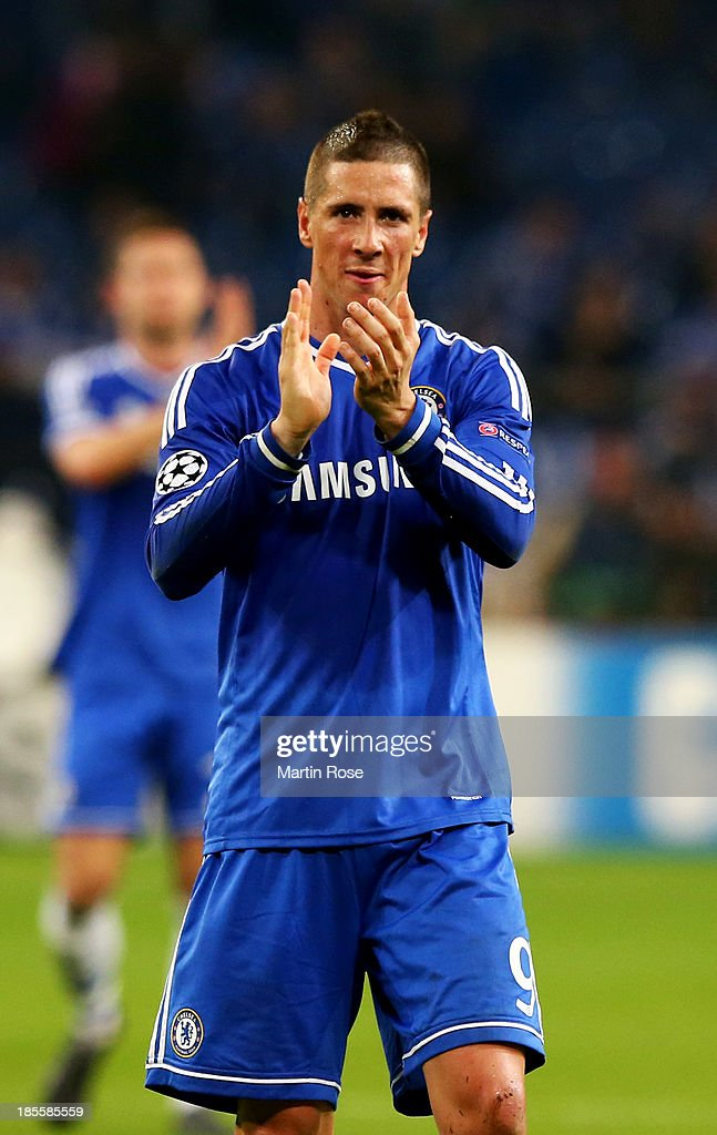 Fernando Torres of Chelsea applauds the travelling fans after the UEFA Champions League Group E match between FC Schalke 04 and Chelsea at Veltins-Arena on October 22, 2013 in Gelsenkirchen, Germany.