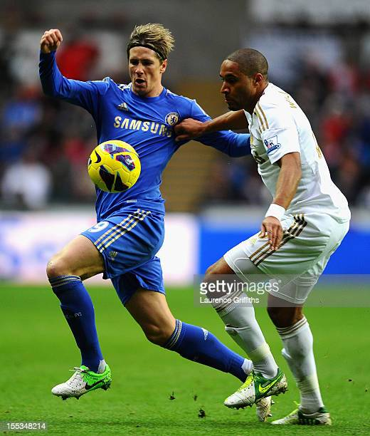 Fernando Torres of Chelsea battles with Ashley Williams of Swansea during the Barclays Premier League match between Swansea City and Chelsea at...