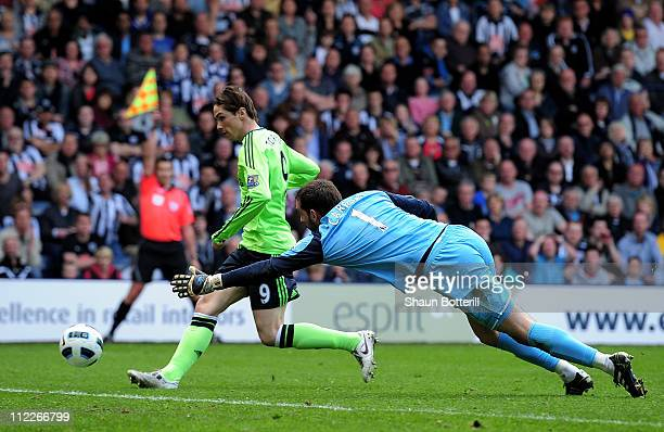 Fernando Torres of Chelsea beats Scott Carson of West Bromwich Albion to score a disallowed goal during the Barclays Premier League match between...