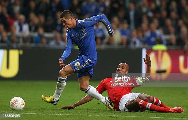 Fernando Torres of Chelsea breaks away from Luisao of Benfica to go on and score the opening goal during the UEFA Europa League Final between SL...