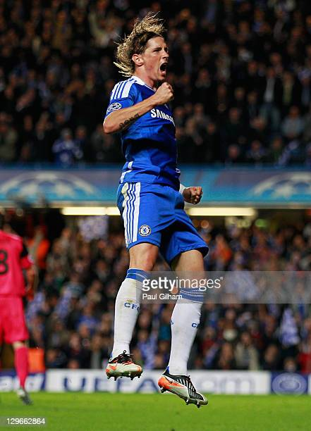 Fernando Torres of Chelsea celebrates as he scores their third goal during the UEFA Champions League group E match between Chelsea and Genk at...