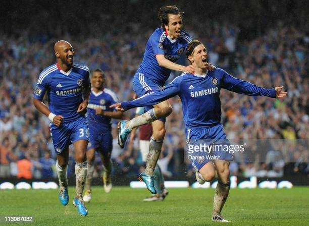 Fernando Torres of Chelsea celebrates scoring his first goal for Chelsea and his team's second goal with team mates Nicolas Anelka and Yossi Benayoun...