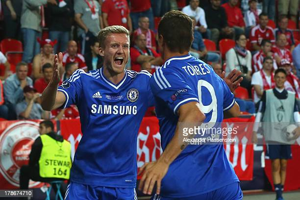 Fernando Torres of Chelsea celebrates scoring the opening goal with his team mate Andre Schuerrle during the UEFA Super Cup between FC Bayern...