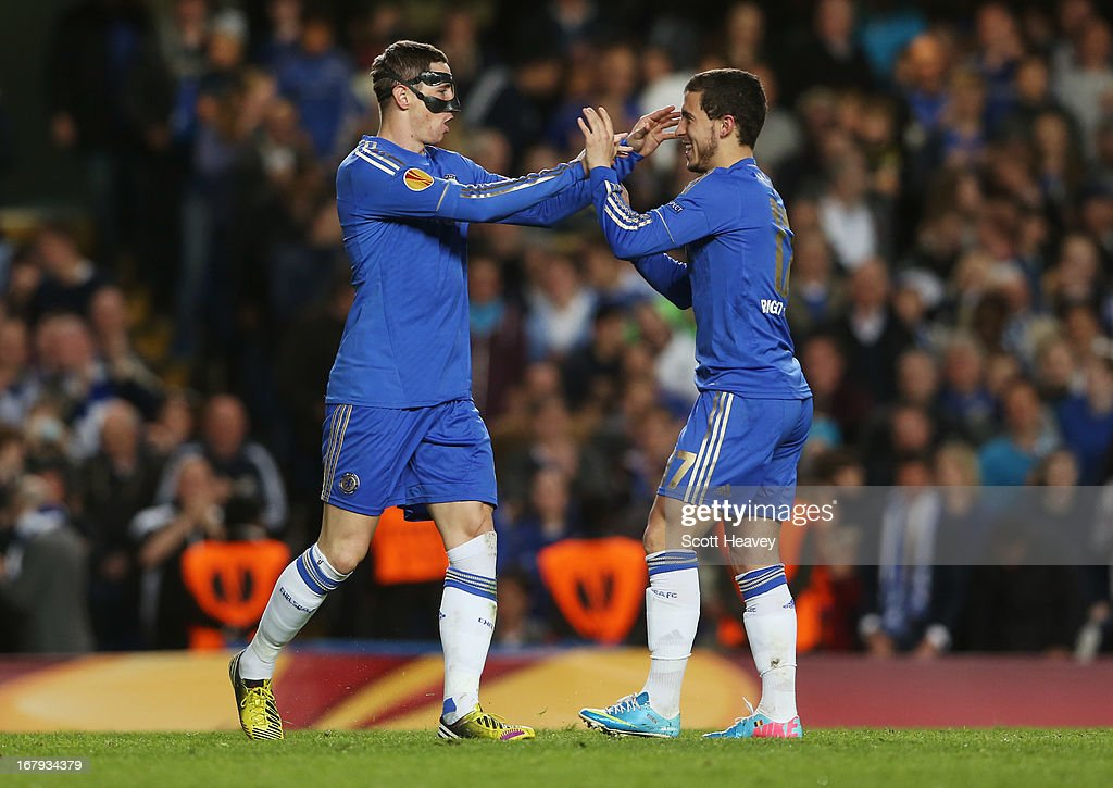 Fernando Torres of Chelsea (L) celebrates with Eden Hazard as he scores their first goal during the UEFA Europa League semi-final second leg match between Chelsea and FC Basel 1893 at Stamford Bridge on May 2, 2013 in London, England.