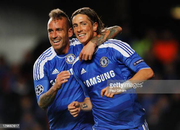 Fernando Torres of Chelsea celebrates with Raul Meireles as he scores their second goal during the UEFA Champions League group E match between...