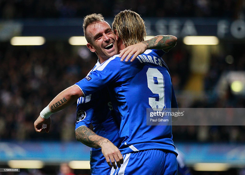Fernando Torres of Chelsea (9) celebrates with Raul Meireles as he scores their third goal during the UEFA Champions League group E match between Chelsea and Genk at Stamford Bridge on October 19, 2011 in London, England.