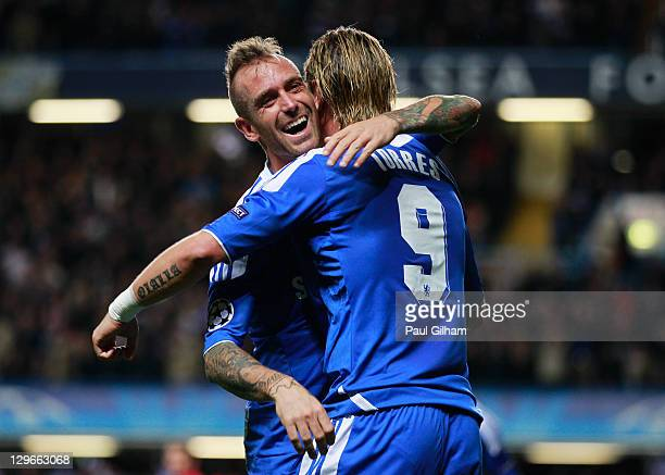 Fernando Torres of Chelsea celebrates with Raul Meireles as he scores their third goal during the UEFA Champions League group E match between Chelsea...