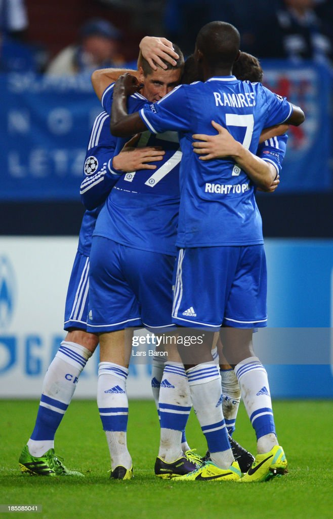 Fernando Torres of Chelsea (L) celebrates with team mates as he scores their second goal during the UEFA Champions League Group E match between FC Schalke 04 and Chelsea at Veltins-Arena on October 22, 2013 in Gelsenkirchen, Germany.