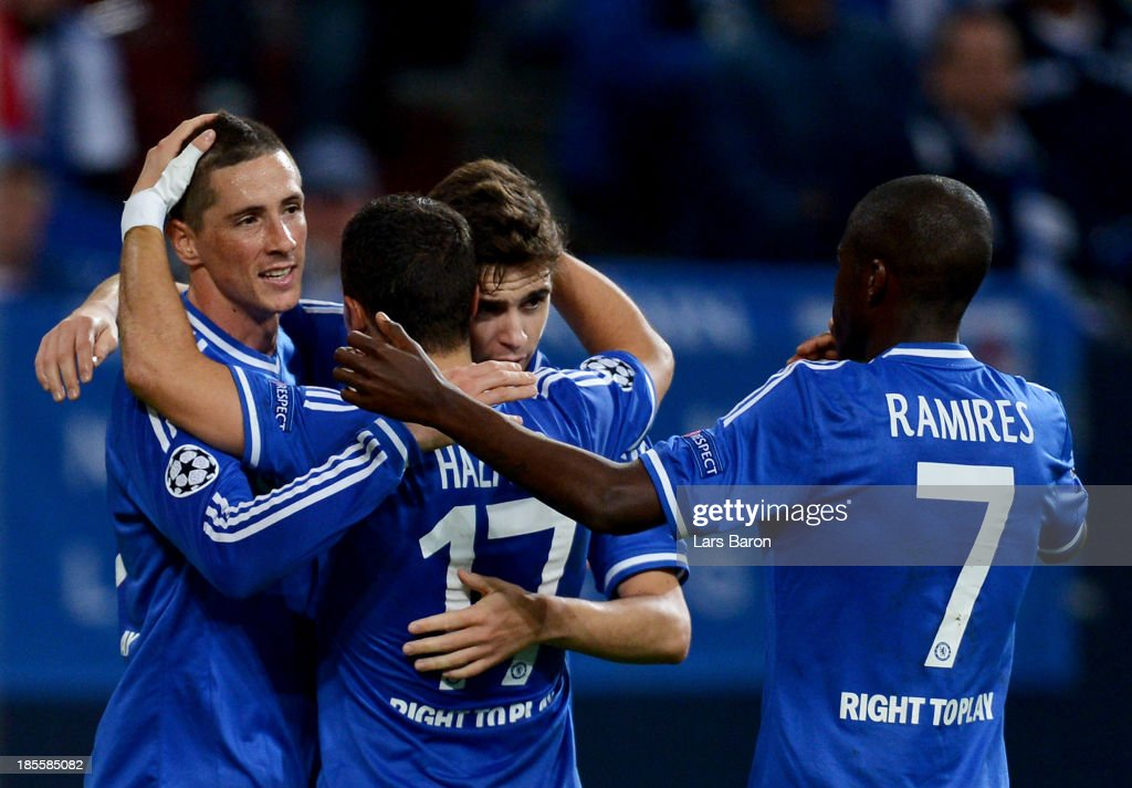 Fernando Torres of Chelsea (L) celebrates with team mates Eden Hazard (2L), Oscar (2R) and Ramires (R) as he scores their second goal during the UEFA Champions League Group E match between FC Schalke 04 and Chelsea at Veltins-Arena on October 22, 2013 in Gelsenkirchen, Germany.