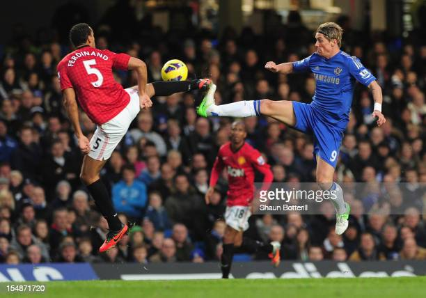 Fernando Torres of Chelsea challenges for the ball with Rio Ferdinand of Manchester United during the Barclays Premier League match between Chelsea...
