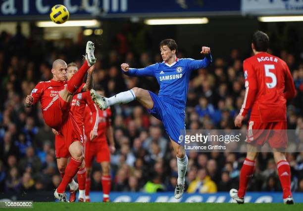 Fernando Torres of Chelsea challenges Martin Skrtel of Liverpool during the Barclays Premier League match between Chelsea and Liverpool at Stamford...