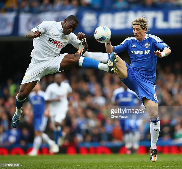 Fernando Torres of Chelsea challenges Maynor Figueroa of Wigan Athletic during the Barclays Premier League match between Chelsea and Wigan Athletic...