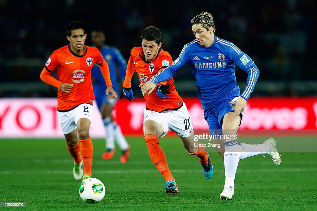 Fernando Torres (R) of Chelsea competes for the ball with Severo Meza and Oscar Garcia of CF Monterrey during the FIFA Club World Cup Semi Final match between CF Monterrey and Chelsea at International Stadium Yokohama on December 13, 2012 in Yokohama, Japan.