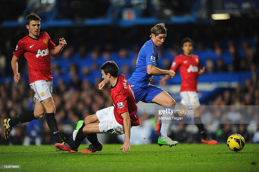 Fernando Torres of Chelsea goes to ground after a challenge by Jonny Evans of Manchester United leading to his sending off during the Barclays Premier League match between Chelsea and Manchester United at Stamford Bridge on October 28, 2012 in London, England.