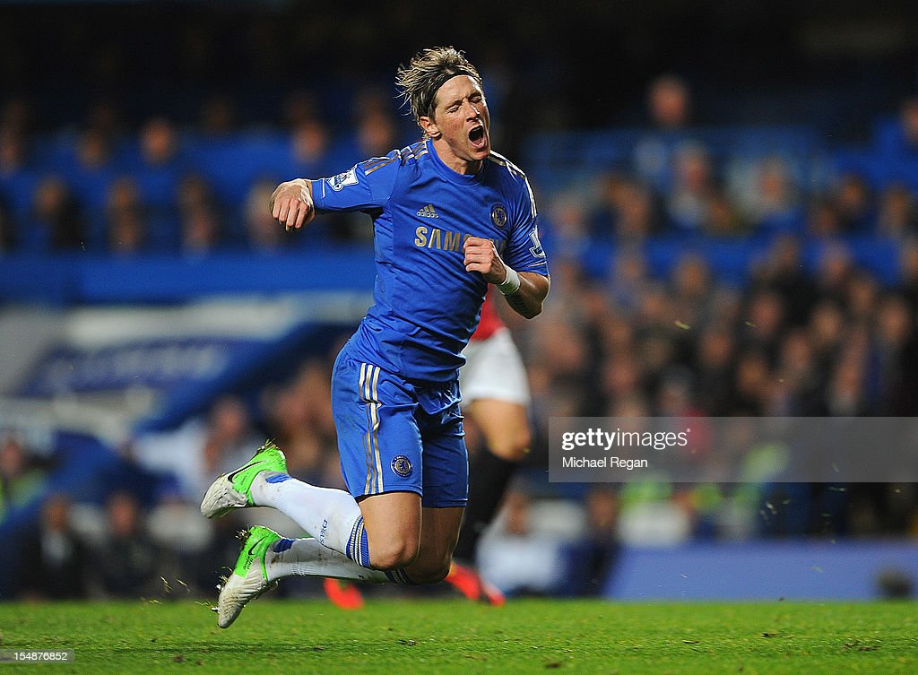 Fernando Torres of Chelsea goes to ground leading to his sending off during the Barclays Premier League match between Chelsea and Manchester United at Stamford Bridge on October 28, 2012 in London, England.