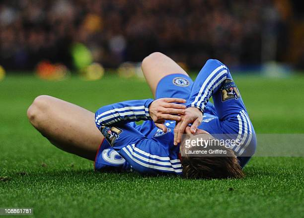 Fernando Torres of Chelsea holds his face after a challenge by Daniel Agger of Liverpool during the Barclays Premier League match between Chelsea and...
