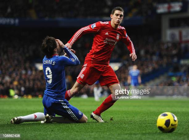 Fernando Torres of Chelsea holds his face after a is challenge by Daniel Agger of Liverpool during the Barclays Premier League match between Chelsea...
