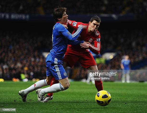 Fernando Torres of Chelsea is challenged by Daniel Agger of Liverpool during the Barclays Premier League match between Chelsea and Liverpool at...