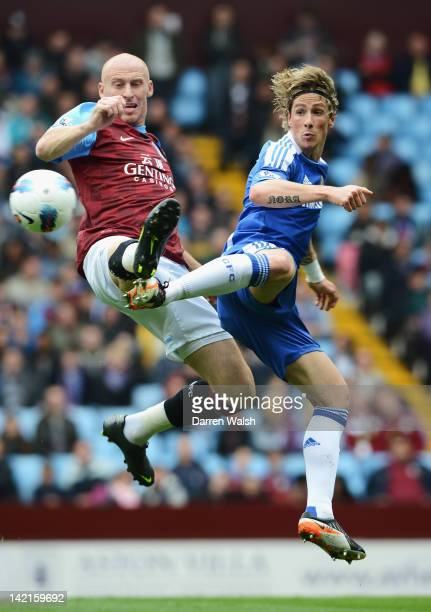 Fernando Torres of Chelsea is challenged by James Collins of Aston Villa during the Barclays Premier League match between Aston Villa and Chelsea at...