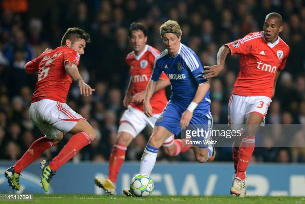 Fernando Torres of Chelsea is closed down by Javi Garcia and Emerson of Benfica during the UEFA Champions League Quarter Final second leg match...