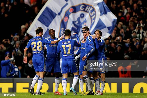 Fernando Torres of Chelsea is congratulated by teammates after scoring his team's third goal with a header during the UEFA Europa League quarter...