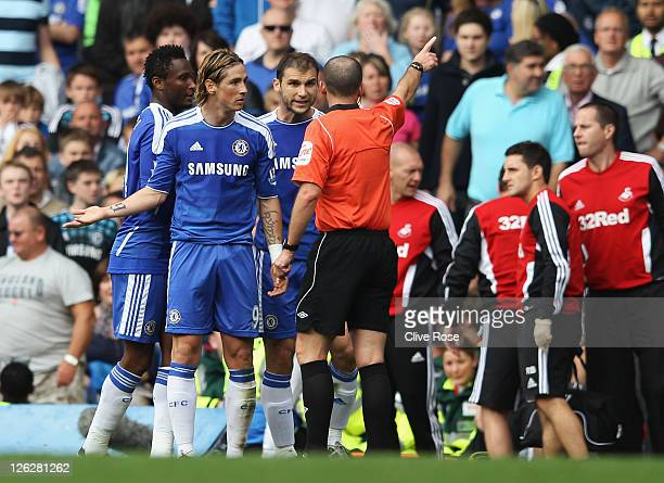 Fernando Torres of Chelsea is sent off by referee Mike Dean during the Barclays Premier League match between Chelsea and Swansea City at Stamford...
