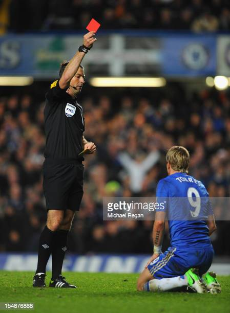 Fernando Torres of Chelsea is shown the red card by referee Mark Clattenburg during the Barclays Premier League match between Chelsea and Manchester...