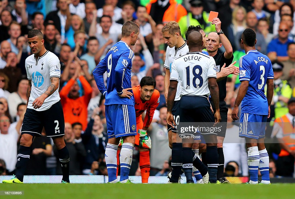 Fernando Torres of Chelsea (9) is shown the red card by referee Mike Dean and is sent off during the Barclays Premier League match between Tottenham Hotspur and Chelsea at White Hart Lane on September 28, 2013 in London, England.