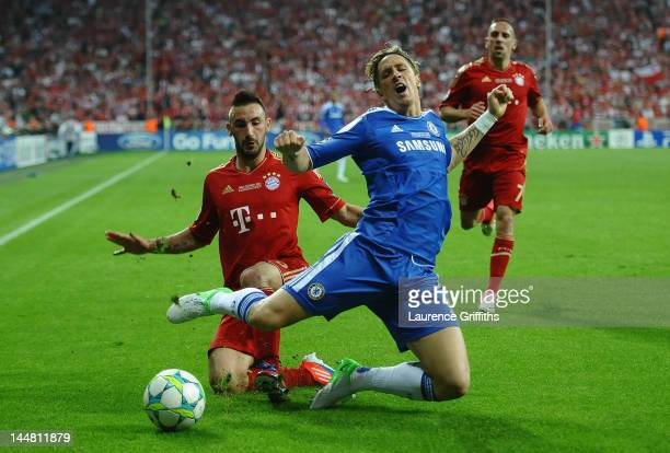 Fernando Torres of Chelsea is tackled by Diego Contento of Bayern Muenchen during UEFA Champions League Final between FC Bayern Muenchen and Chelsea...