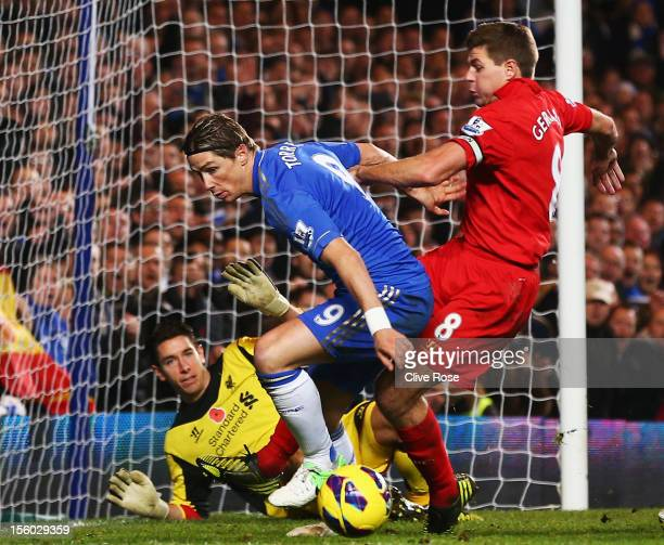 Fernando Torres of Chelsea is tackled by Steven Gerrard of Liverpool during the Barclays Premier League match between Chelsea and Liverpool at...